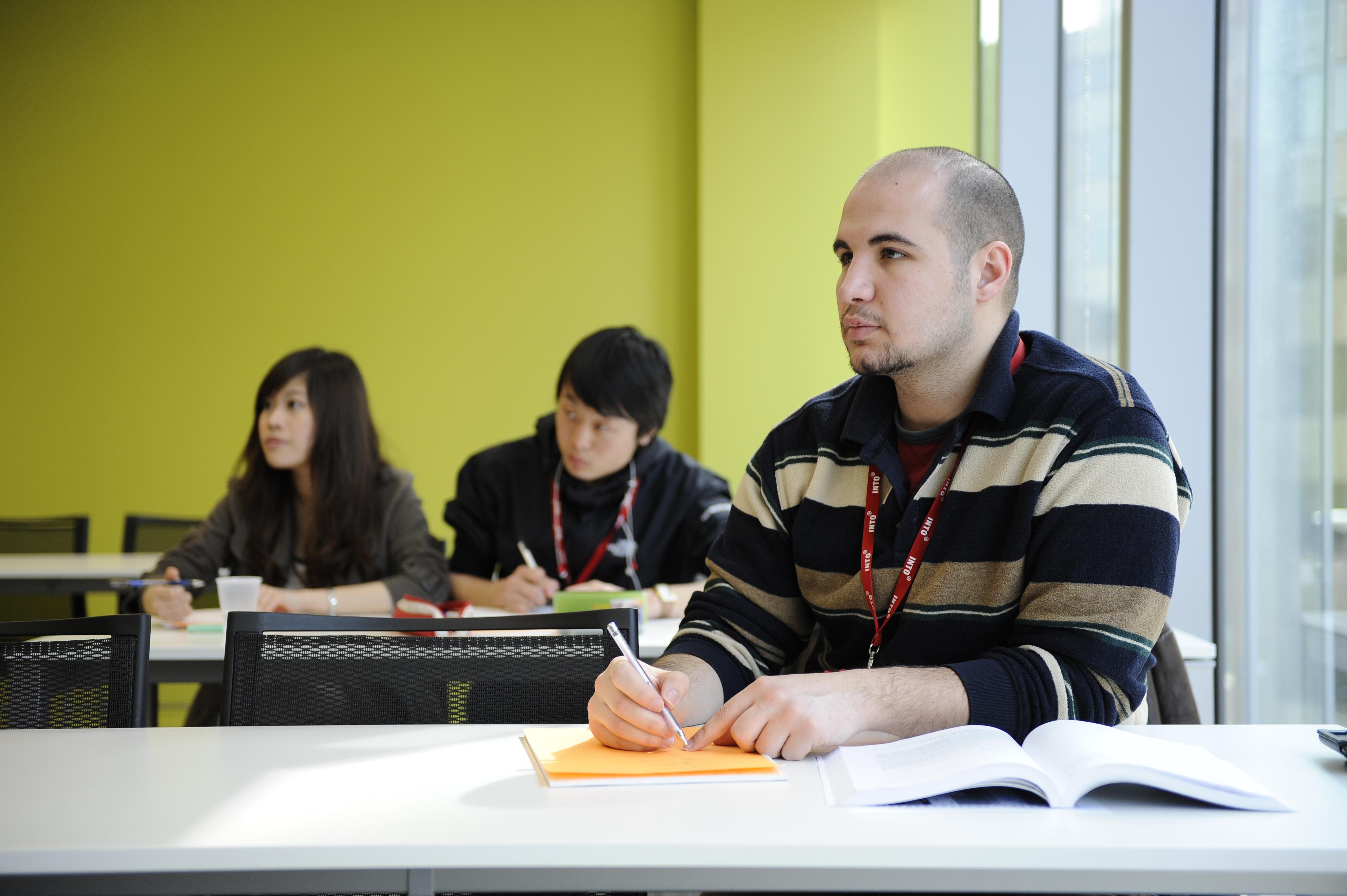 Three international students study LLB Law