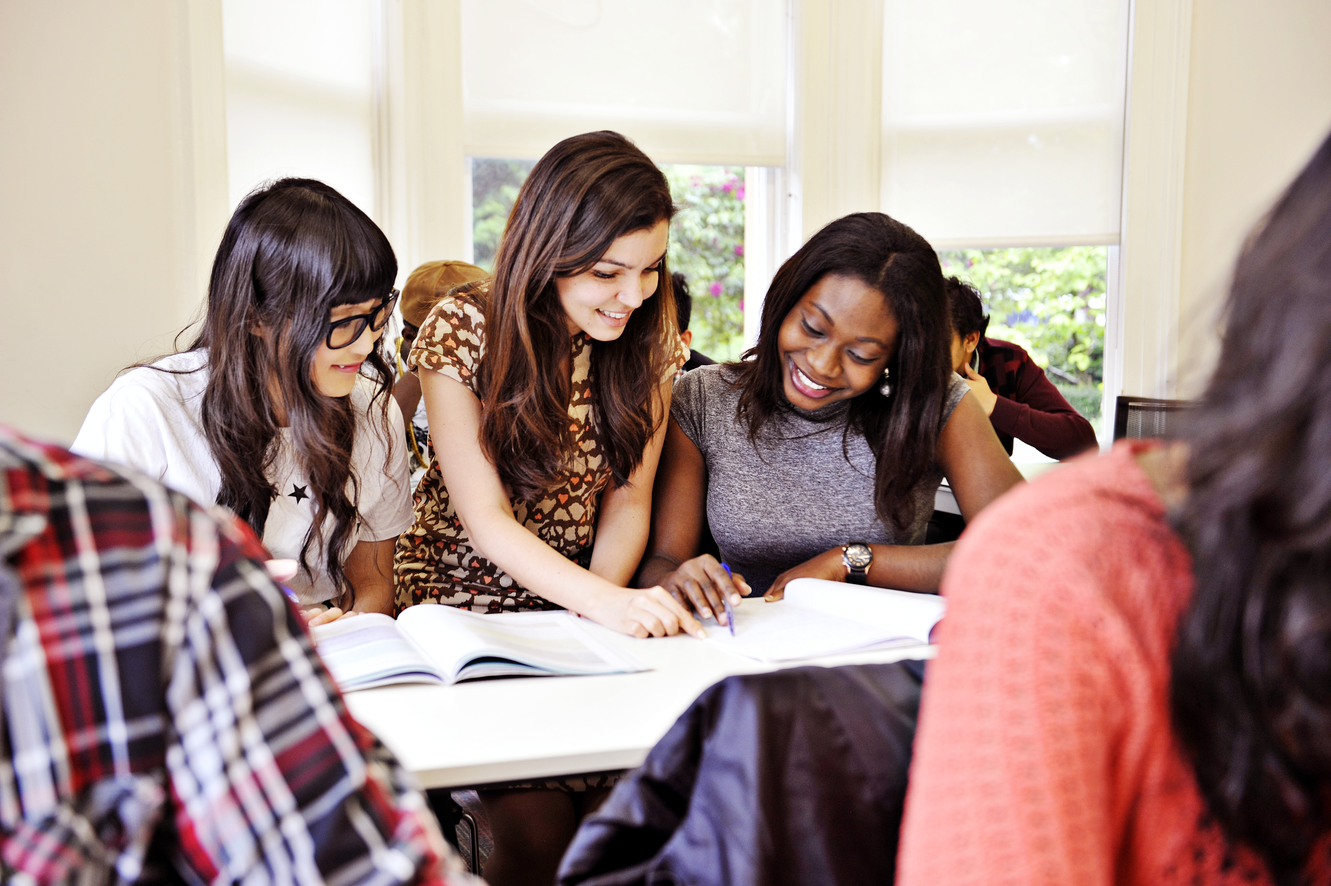 INTO international students take part in group work