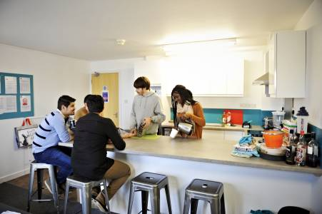 Students socialising in a shared kitchen at Liberty Park student residences at GCU