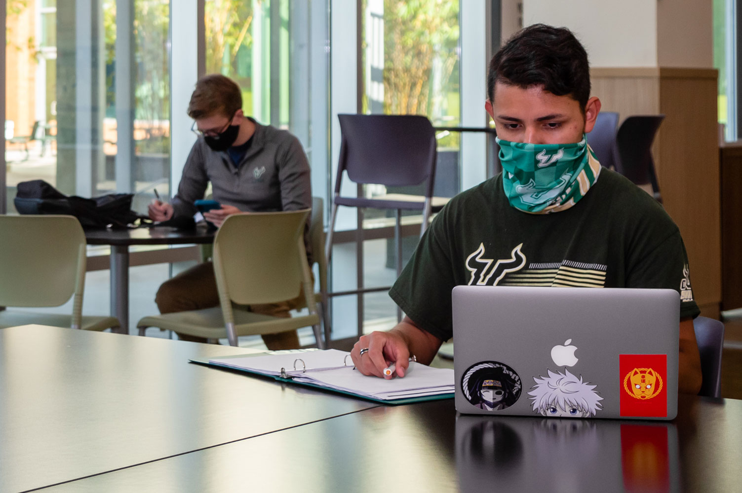 USF Students with Masks and online learning