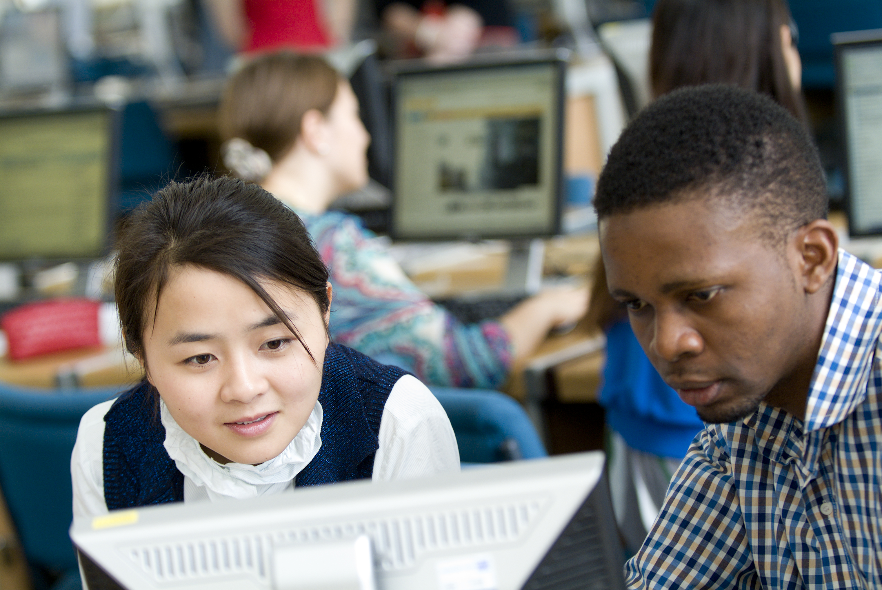 Two international students in computer lab