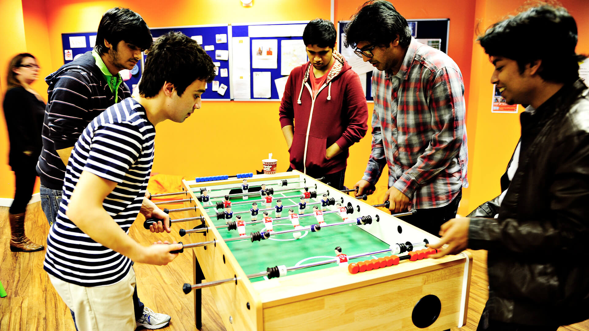 Students socialising in a break-out area at INTO Manchester