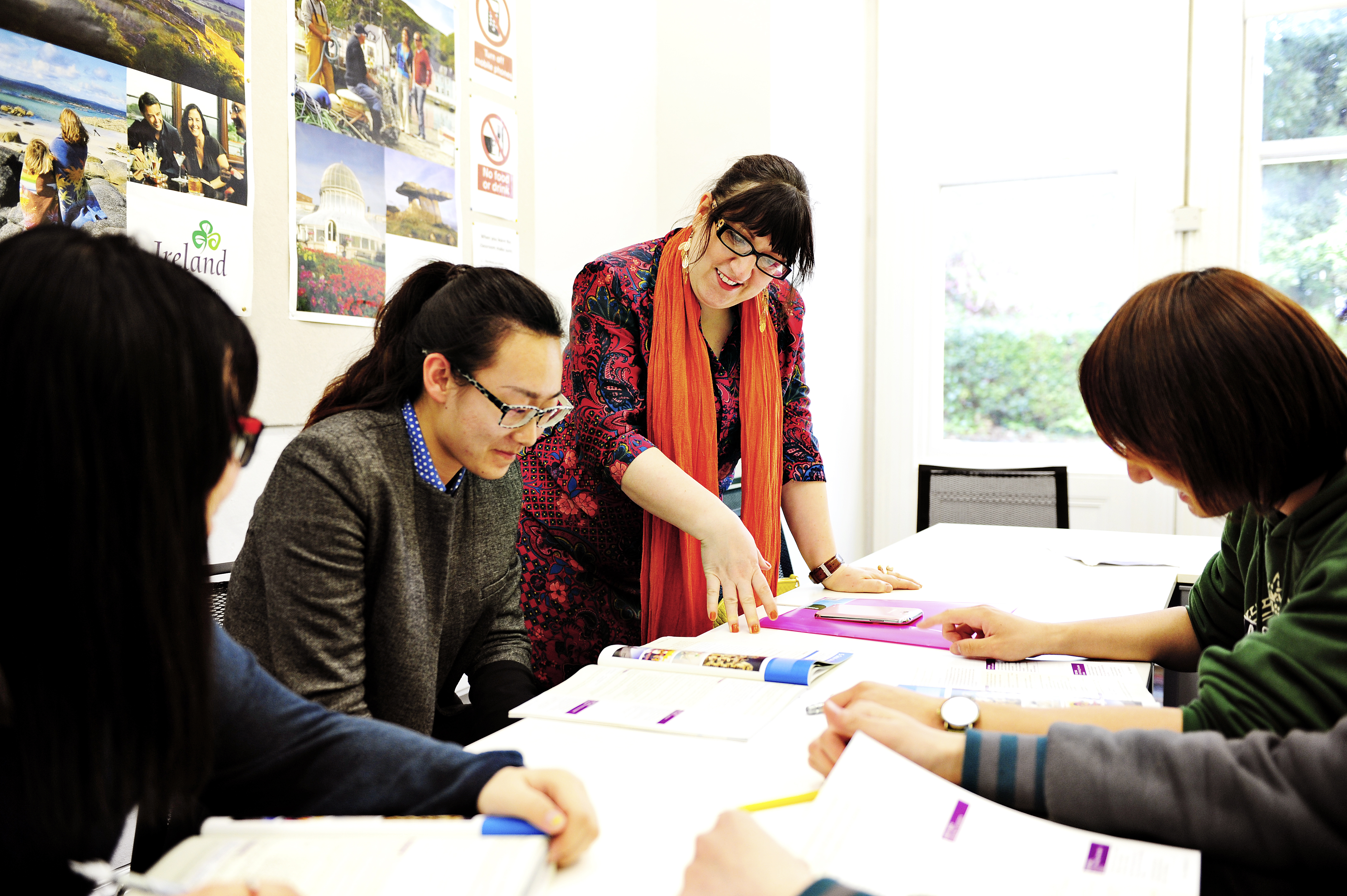 INTO International students learning as a group from textbooks