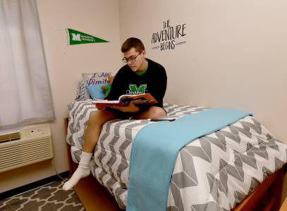 Marshall accommodations male student reading bed