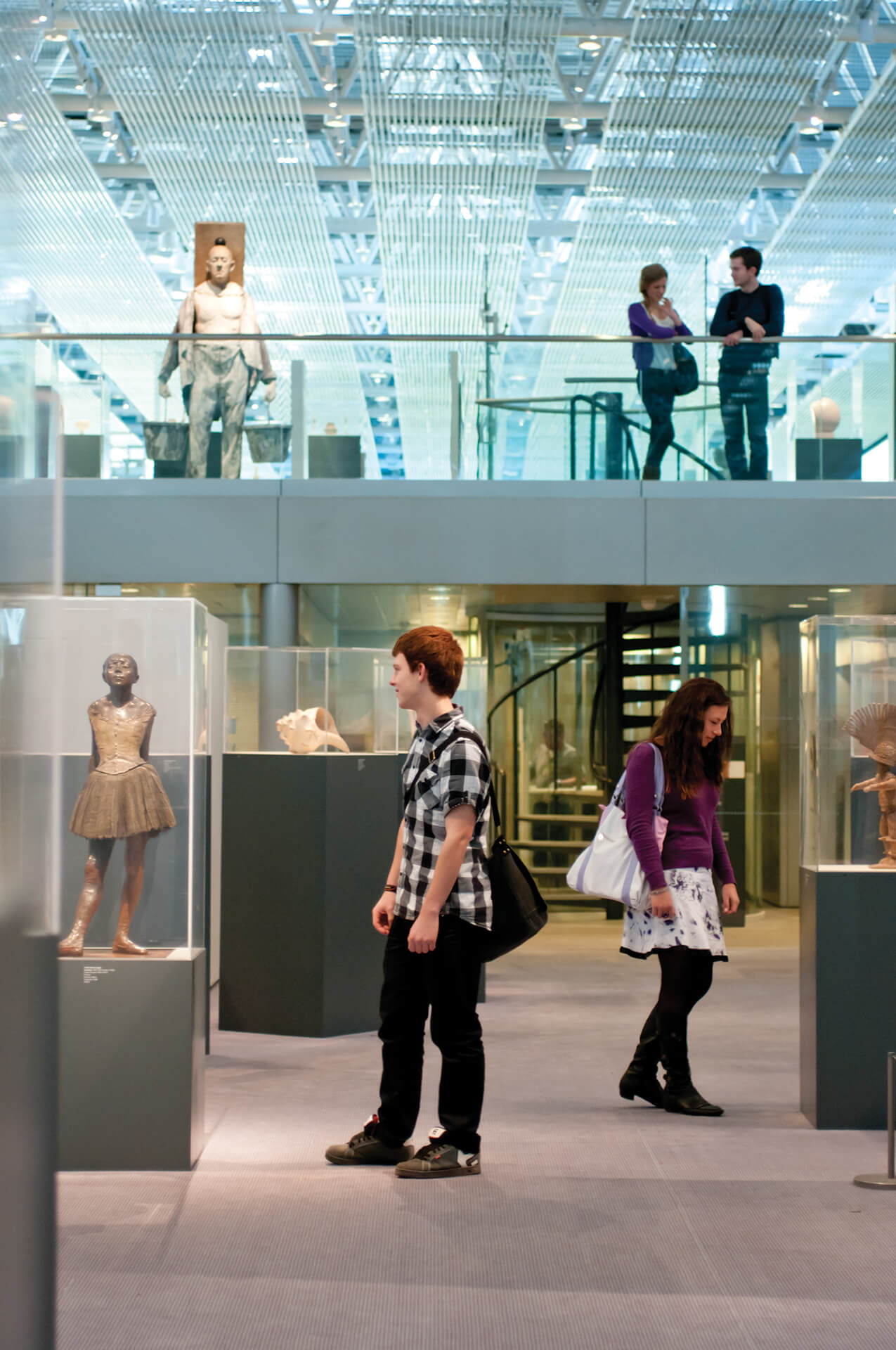 Students looking at art in the Sainsbury Centre
