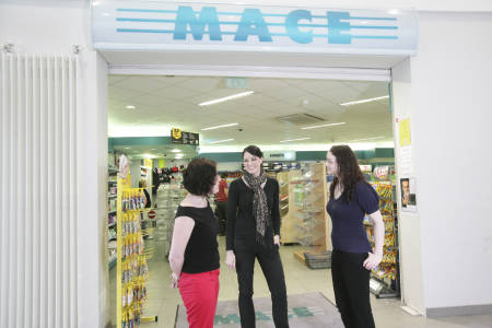 International students outside Mace grocery store