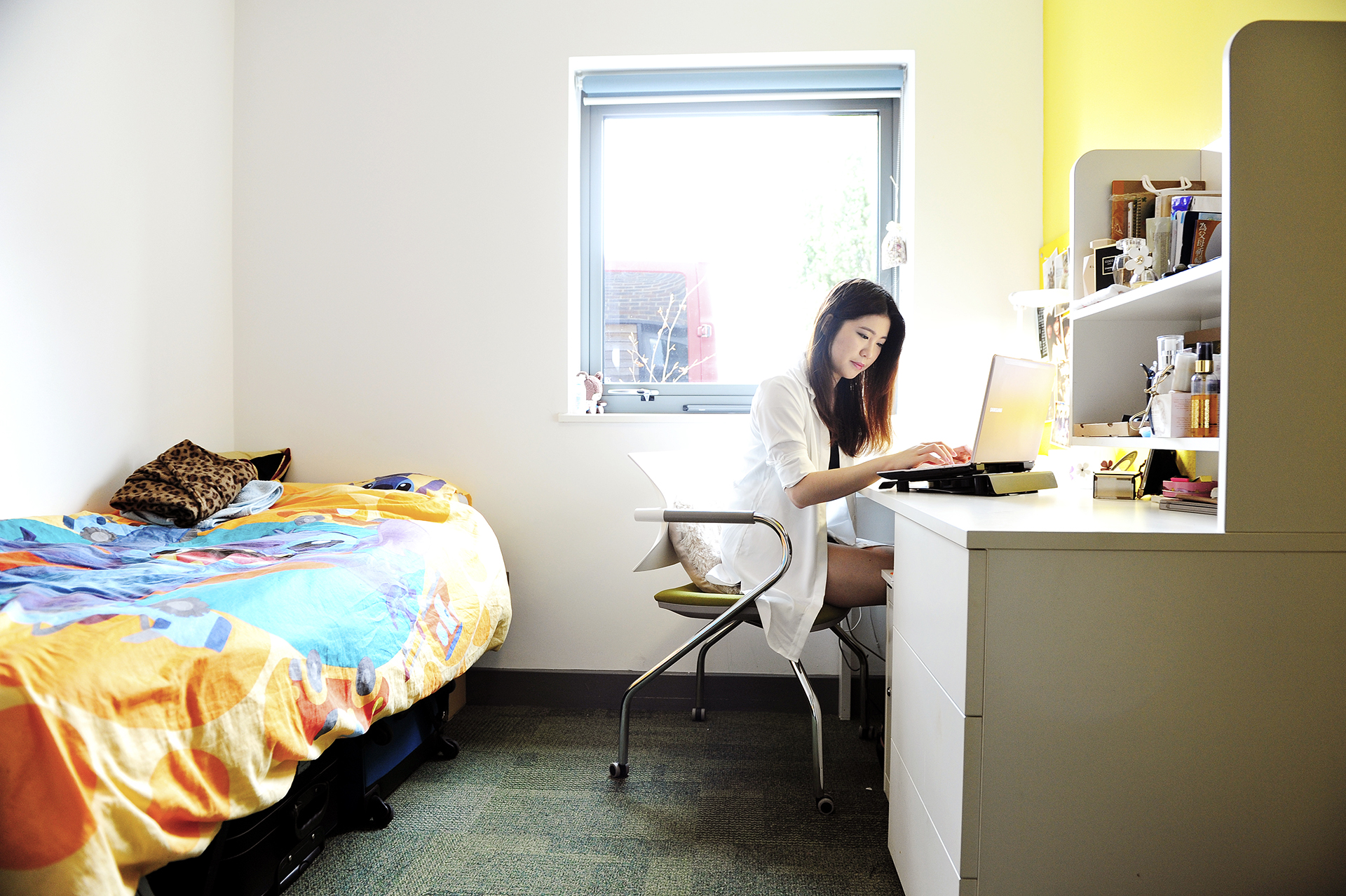 Student studying in a Single room at INTO University of Exeter student residences