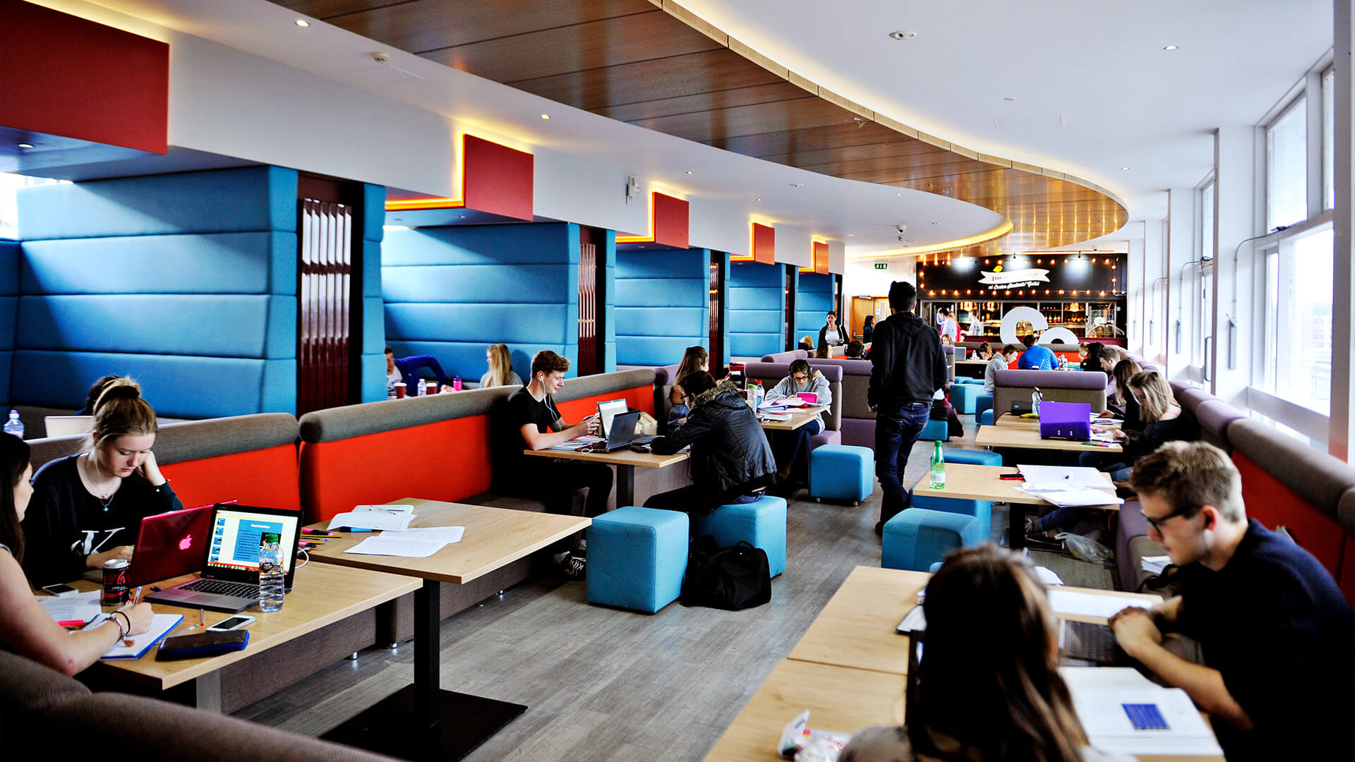 Students socialising and studying in campus cafe at University of Exeter