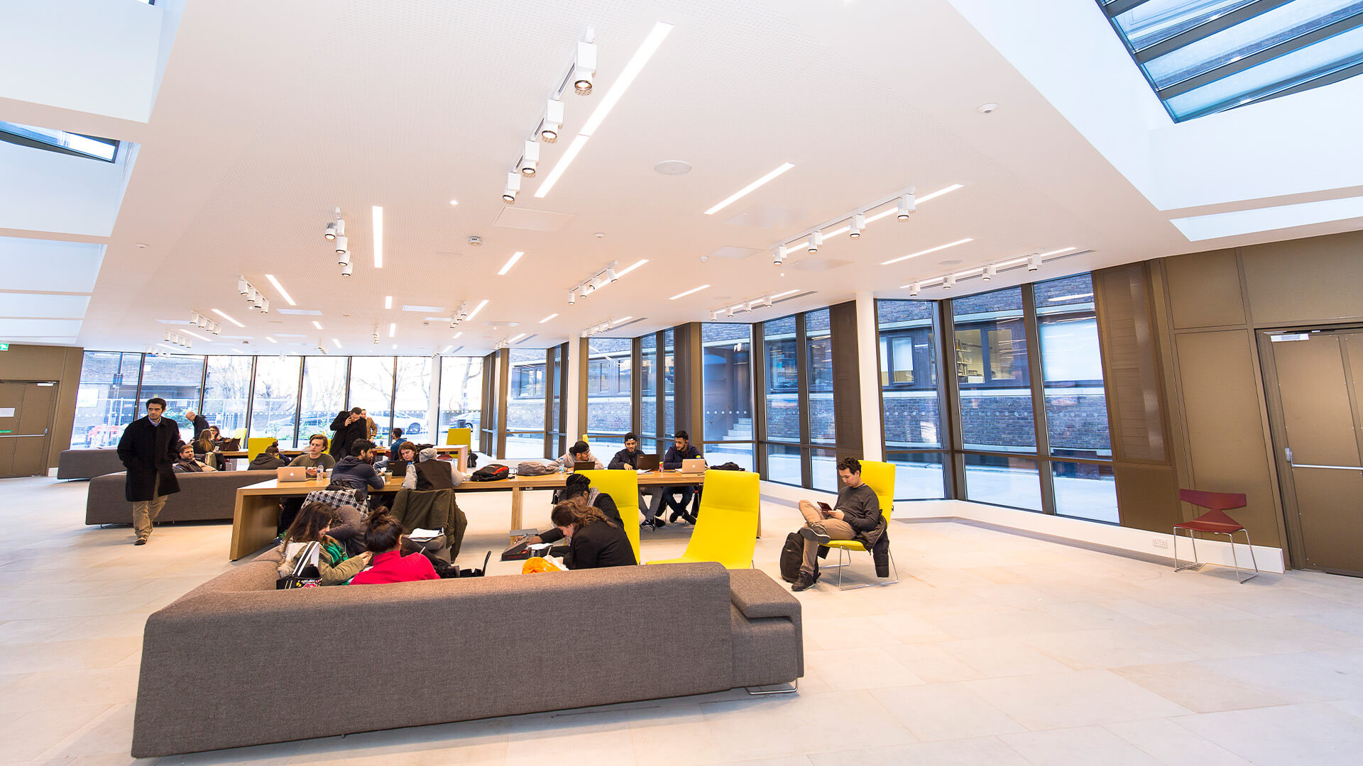 Students relaxing and studying on campus at City, University of London