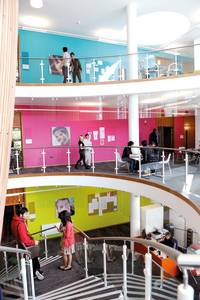 Inside INTO Centre with international students on staircase