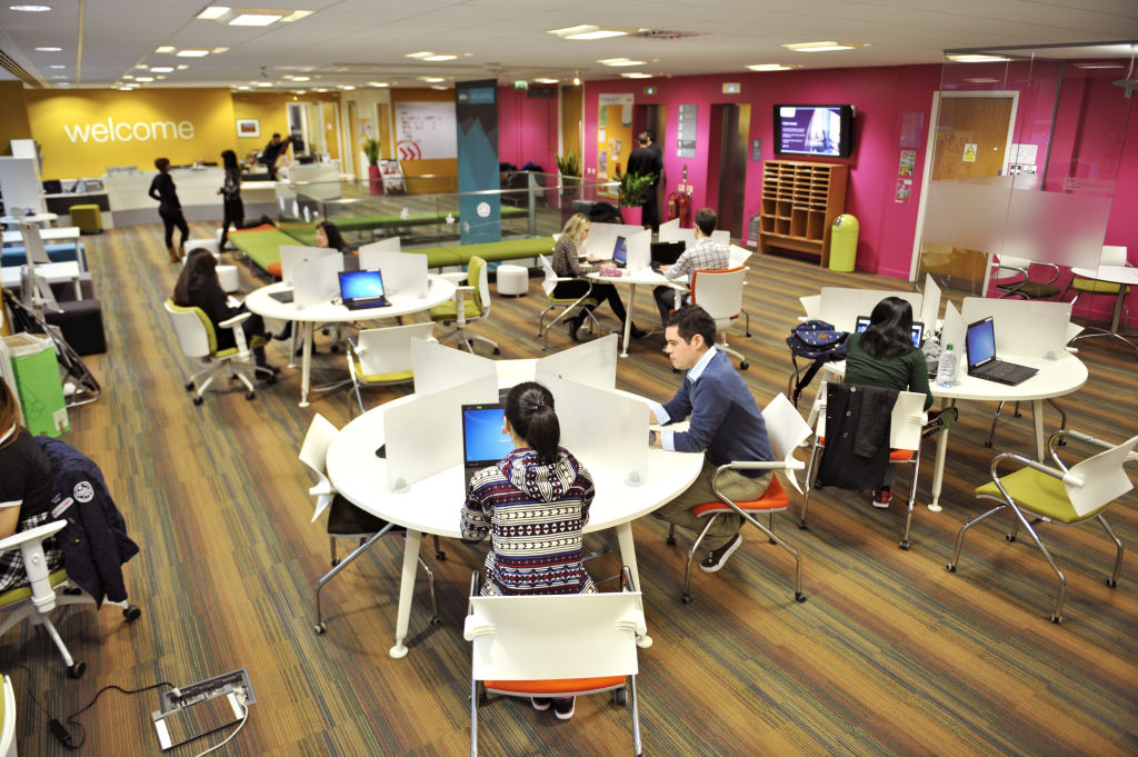 Students using the 2nd floor welcome desk area