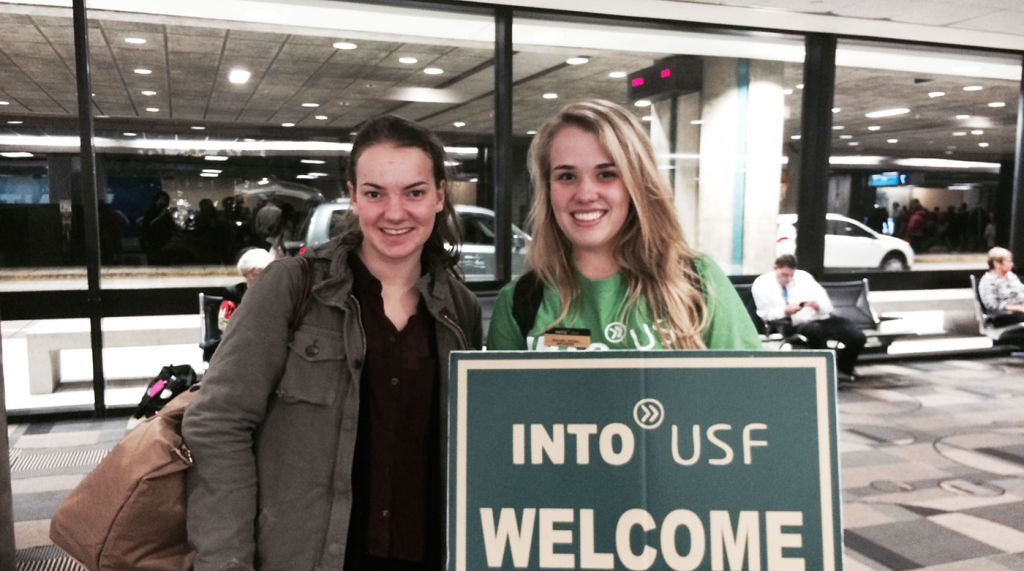 INTO students get welcomed at the airport in Tampa