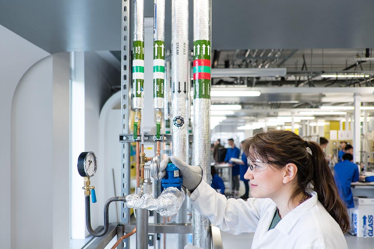 INTO international student using chemical engineering equipment