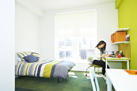 A student in a single studio room in INTO Bernicia Halls student residences